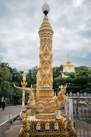 Cygnus Light Pole Light Post Thai Temple Architecture Building Exterior Built Structure Cloud - Sky Day Gold Colored Mythical Bir No People Outdoors Place Of Worship Religion Sculpture Sky Spirituality Statue Temple Temple - Building Temple Architecture Travel Destinations Tree