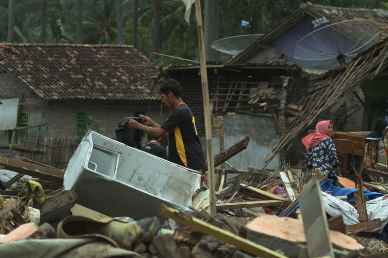 Tsunami Aftermath in Lampung, Indonesia Men Real People Day People Occupation Architecture Lifestyles Transportation Adult Built Structure Outdoors Working Mode Of Transportation Nature Building Exterior Women Casual Clothing Market Two People Tsunami Tsunami Disaster Lampung INDONESIA