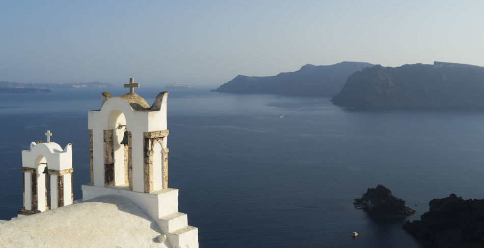 Watching over Santorini Greece Photos Greek Islands Greek Church Oia Santorini Santorini Greece Santorini Island Santorini, Greece Beauty In Nature Clear Sky Greece Greece Islands Horizon Over Water Nature No People Religion Santorini Santorini View Sea Spirituality Tranquility Water EyeEmNewHere