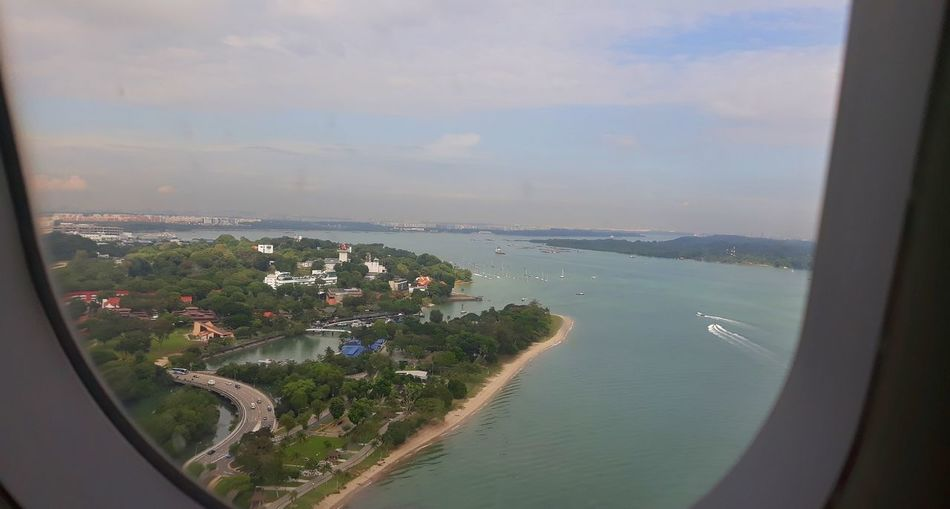 view from a plane Sea Water Aerial View Cityscape Window Looking Through Window Travel Destinations City No People Architecture Sky Beach Day Vacations Outdoors Horizon Over Water Nature Singapore Singapore View View From Above View From An Airplane View From The Airplane Window