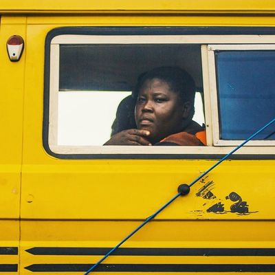A woman traveling in Danfo , stuck in traffic near Ikeja . Streetphotography Snapitoga everydayAfrica Lagos Nigeria lagosnigeria Nigerian nigrrianwoman Africa
