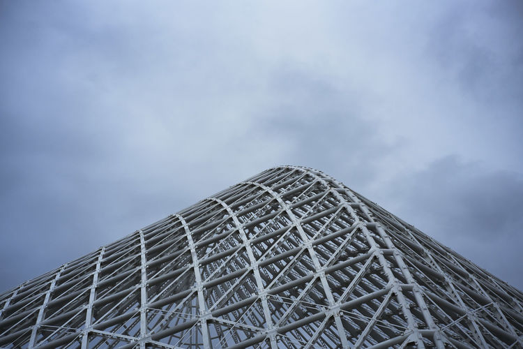 Low Angle View Of Metallic Roof Against Sky