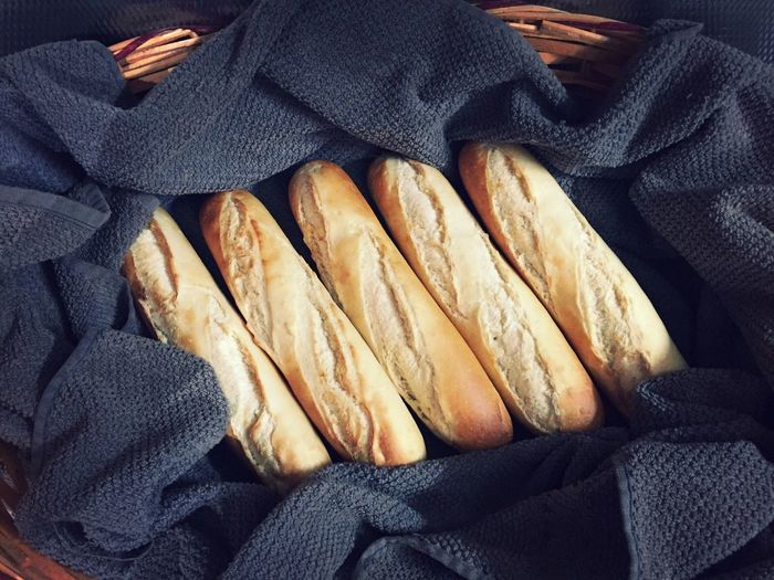 Close-up of baguette on fabric
