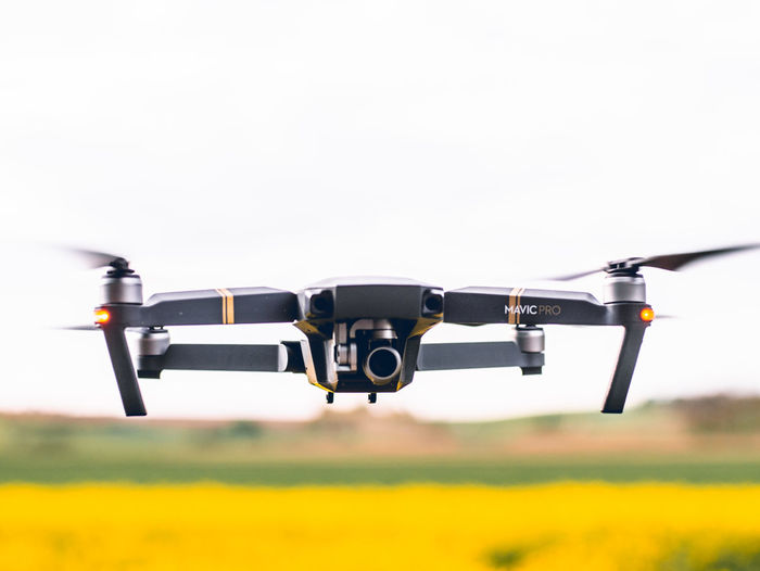 Flying Air Vehicle Mode Of Transportation Transportation Airplane Sky Nature Motion Technology Field Camera - Photographic Equipment Focus On Foreground No People Day Mid-air Outdoors Yellow on the move Drone  Photography Themes Aerospace Industry Plane DJI Mavic Pro Mavic Pro Dji