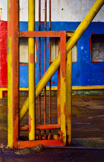 Detail of old decaying rusty barge boat in Holbox, Mexico Barge Mexico Rust Abstract Architecture Blue Boat Built Structure Commercial Dock Day Decal Holbox Industry Metal Multi Colored No People Outdoors Pipe - Tube Primary Colors Red Yellow Yucatan Mexico
