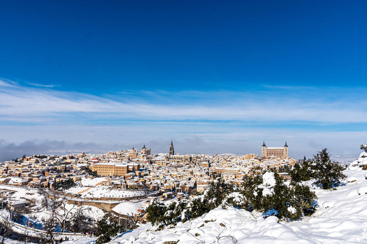 View of townscape against sky during winter