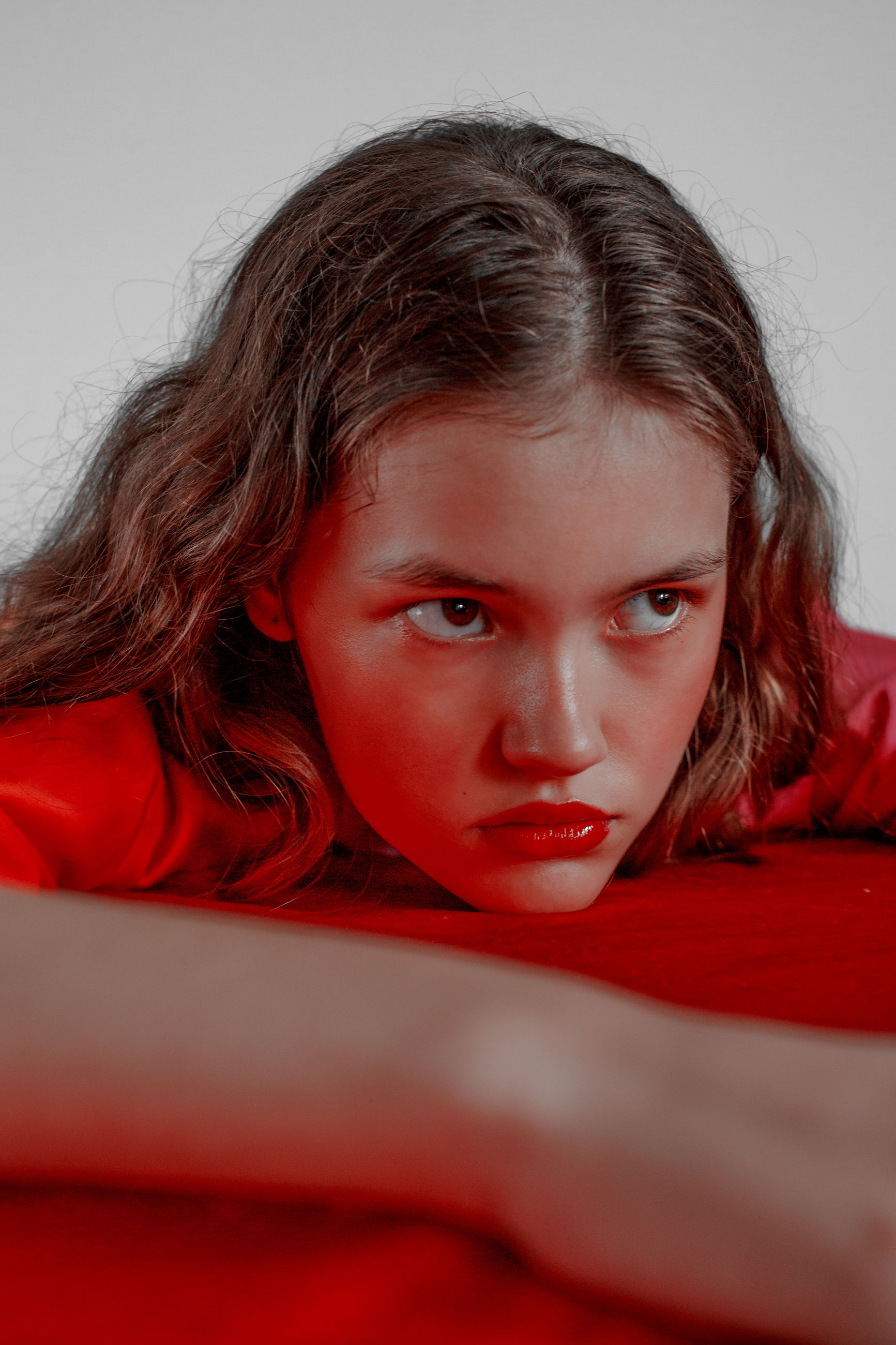 portrait, looking at camera, headshot, one person, indoors, red, front view, young adult, women, lifestyles, real people, studio shot, child, close-up, hairstyle, brown hair, females, gray, contemplation, innocence, teenager, human face