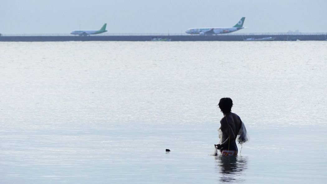 Bali Bali Indonesia Bali, Indonesia Planespotting Waiting Day Men Nature Ngurah Rai International Airport Ngurahrai Ngurahraiairport One Person Outdoors People Planes Real People Sea Sky Two Planes Water Waterfront