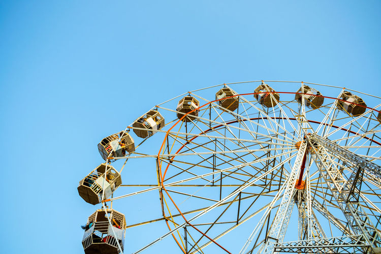 Activity Street Hanging Out Golden Hour Light Human Body Part Big Wheel People Streetphotography Arts Culture And Entertainment Ferris Wheel Low Angle View Clear Sky Outdoors Day Sky #urbanana: The Urban Playground