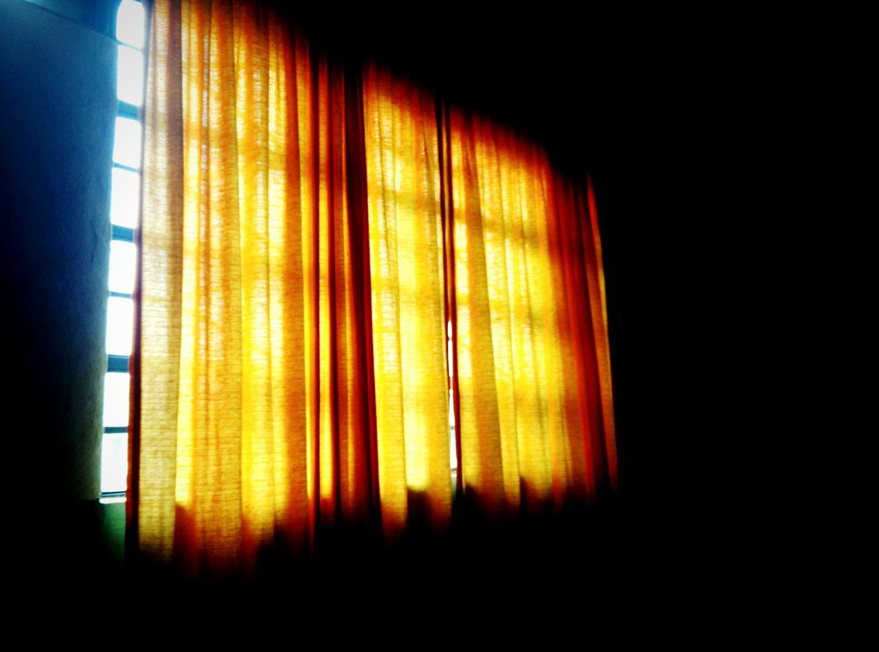 Yellow curtain on window