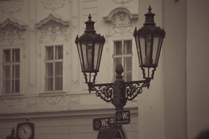 City Moment Prague Sign Architecture Building Exterior Built Structure City Close-up Day Lantern Light And Shadow No People Old Outdoors Street Time Town