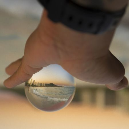 Waikiki Beach in a crystal ball Creativity Crystal Ball Hawaii Waikiki Waikiki Beach Body Part Close-up Focus On Foreground Hand Holding Human Body Part Human Finger Human Foot Human Hand Human Limb Lifestyles One Person Real People