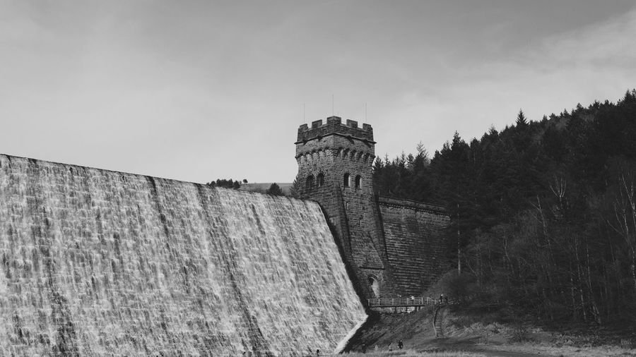 Low angle view of derwent dam against sky