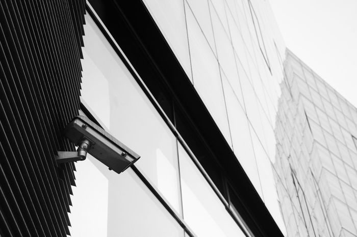 """"""" I see you """" Camera Architecture Building Building Exterior Built Structure City Clear Sky Close-up Day Low Angle View Minimalism Modern Nature No People Office Office Building Exterior Outdoors Pattern Sky Skyscraper Surveillance Camera Technology Wall Wall - Building Feature Window The Architect - 2018 EyeEm Awards"""