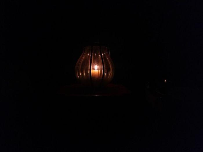 Close-up of illuminated lamp in the dark