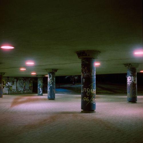 Illuminated street lights in building at night