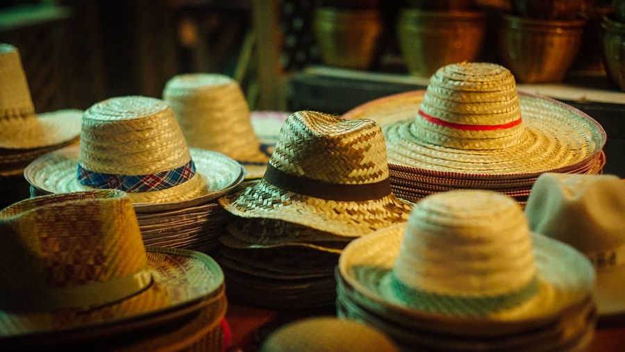 Close-up of hats for sale in market