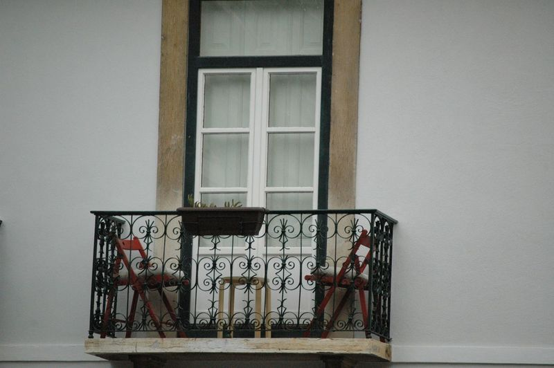Chairs and stool on building balcony