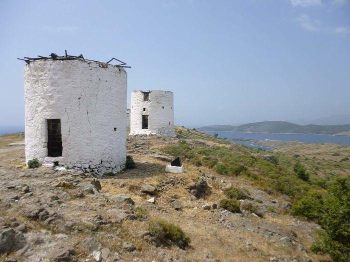 Broken Abandoned White Buildings Against Sky