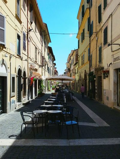 Architecture Building Exterior Street Outdoors City Built Structure Travel Destinations Sky No People Day Italy Italia Italian Town Town Tables And Chairs Tables In The Street Table Outdoors Street Life