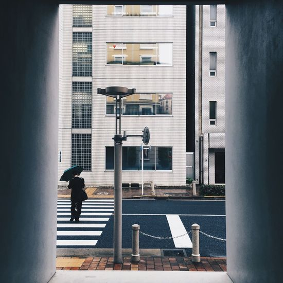 Crossing Japan ASIA Travel EyeEm Selects Architecture Built Structure Building Exterior City Day Real People Window Street Men Walking Lifestyles One Person City Life Building The Architect - 2018 EyeEm Awards The Street Photographer - 2018 EyeEm Awards The Great Outdoors - 2018 EyeEm Awards The Still Life Photographer - 2018 EyeEm Awards The Traveler - 2018 EyeEm Awards EyeEmNewHere