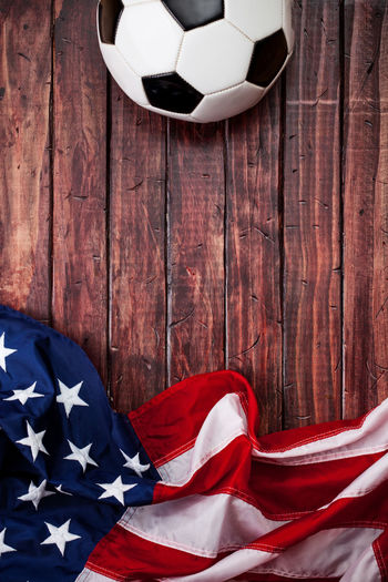 Close-up of flag and soccer ball on table