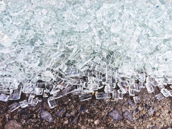Glass particles on ground