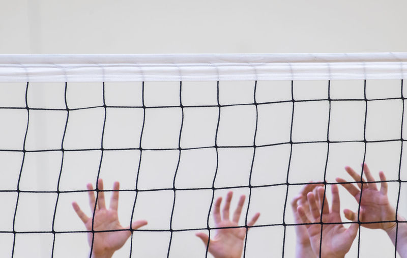Cropped hands playing volleyball