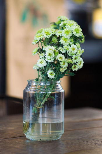 Close-up of glass vase on table