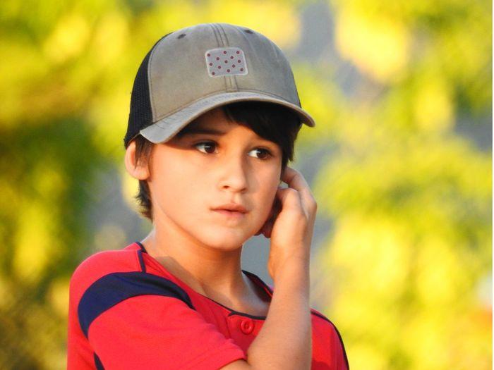Boy wearing cap looking away