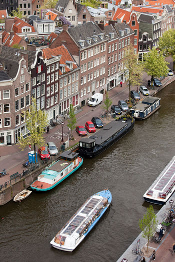 High angle view of boats moored in river in city