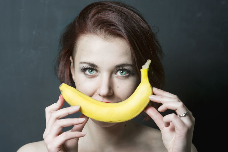 Portrait of young woman holding a banana Banana Funny Makeup Smile ✌ Woman Girl Healthy Healthy Lifestyle Portrait Smile