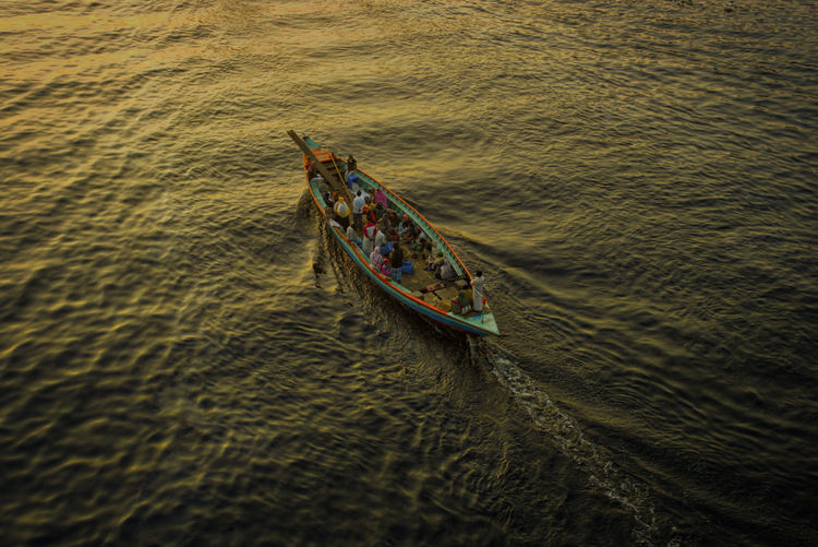 High angle view of boat sailing in water