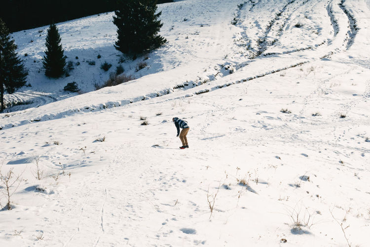 Sliding down the snowy hills Snow Winter Cold Temperature Extreme Weather Snowcapped Mountain Beauty In Nature Day Nature Field Land Covering White Color Board Slide Slide Board Sport Winter Sport Slope Downhill Pine Tree Holiday Vacation Fun Adult Snowboarding