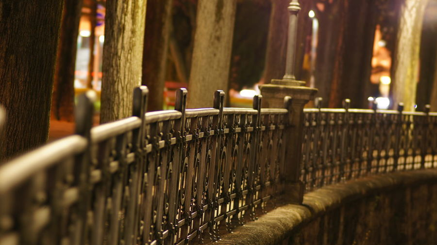 View of metal fence at night