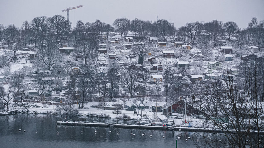 High angle view of trees and buildings in city during winter