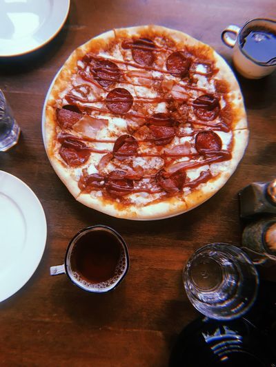 Directly above shot of pizza with drink on table