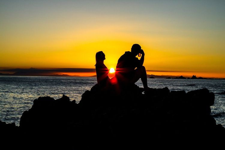 Sunset with friends on a calm Wellington evening Sunset Silhouette Water Sea Tranquil Scene Scenics Orange Color Beauty In Nature Standing Tranquility Sun Vacations Horizon Over Water Dramatic Sky Beach Atmosphere Nature Romantic Sky Atmospheric Mood Back Lit Ocean Coastline Idyllic Calm Tranquility