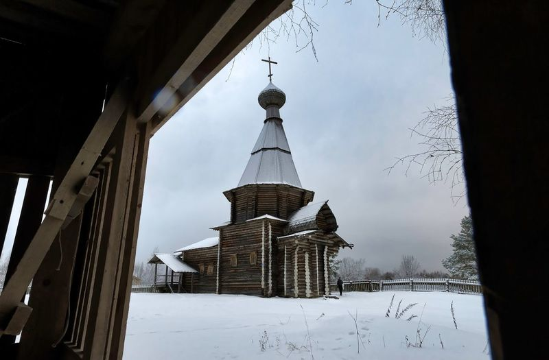 Traditional building against sky during winter