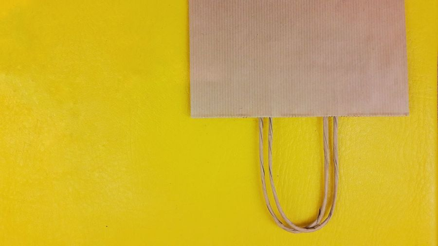 Bag Paper Paper Bag Yellow Backgrounds Wood - Material Close-up Yellow Background Shopping Mall Shopping Bag Shopaholic