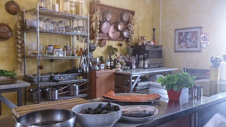 a Tuscan country kitchen Chef Country Kitchen Food Foodporn Indoors  Italy Kitchen Lucca Macro Pots And Pans Still Life Table Tuscanny Vegatables Wine