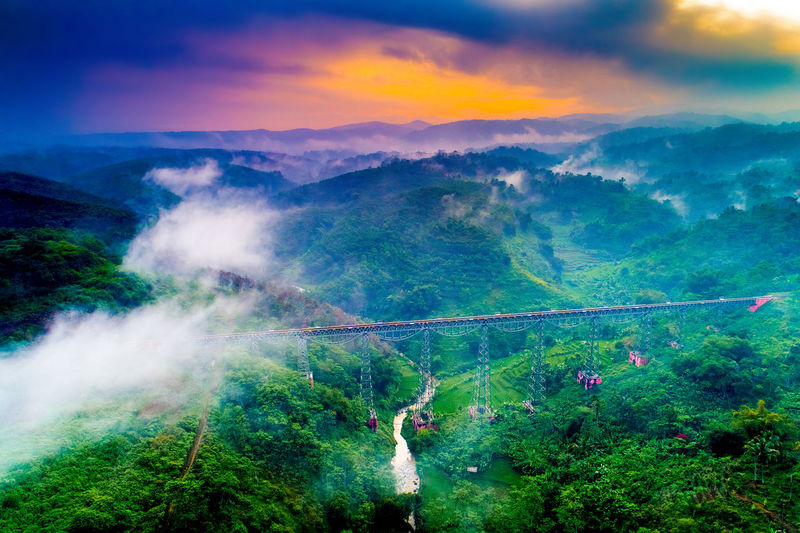 Aerial View of Cikubang Bridge at Sunrise, the Longest Active Train Bridge in Indonesia, Bandung, West Java, Asia Cloud - Sky Tree Beauty In Nature Scenics - Nature Plant Sky Tranquil Scene Forest Tranquility Green Color Nature Environment Outdoors INDONESIA Bandung Aerial View Aerial Shot Aerial Photography Aerial Landscape Railway Bridge Longest Railway Bridge Architecture