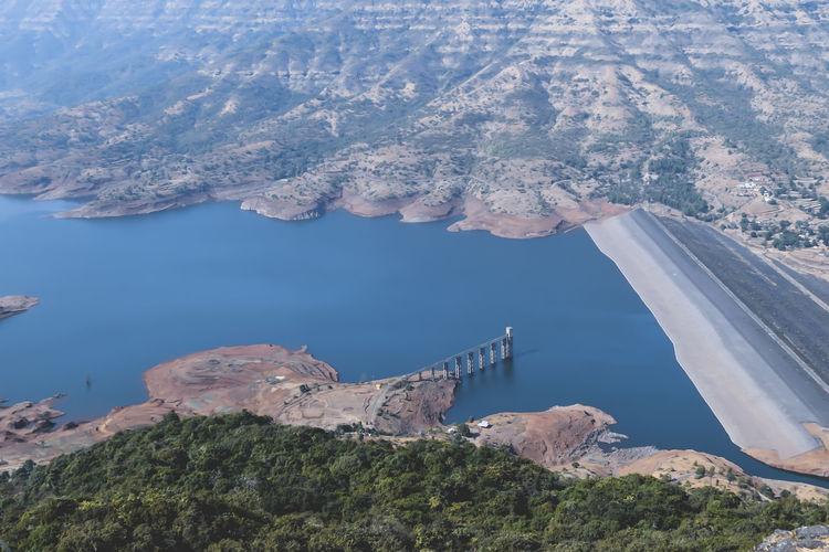 High Angle View Of Lake Amidst Rocks