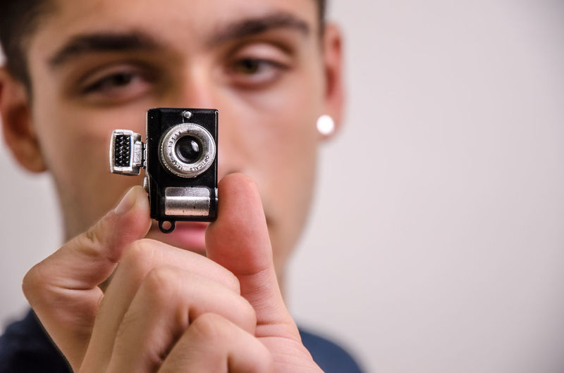 Close-up portrait of man photographing