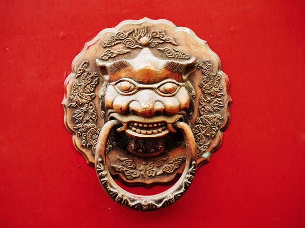 Door knob at ancient Chinese gate Artsy Asian Culture Beijing Forbidden City Ornamental Architecturelovers Art And Craft Brass China Chinese Culture Close-up Day Door Door Knob Forbidden City, Beijing, China Lion - Feline Lions No People Outdoors Red Sculpture Statue