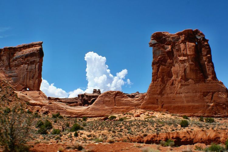 Low angle view of rocky mountains at arches national park
