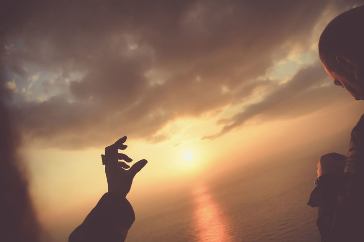Capture Tomorrow Sky Sunset Silhouette Cloud - Sky Water Hand Real People Gesturing Lifestyles Scenics - Nature Leisure Activity Human Hand Nature Beauty In Nature Sea Human Body Part Sun People Tranquility Outdoors Finger Human Arm Arms Raised Human Limb