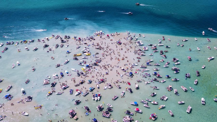 4th Of July Lake Michigan Party Boat Summer Season  Recreation  Holiday Leasure Activity Aerial Clear Water Yacht Luxary Lifestyle Vacation People Fun Outdoors Family Togetherness Crowd Water Aerial View Blue High Angle View Beach Sand Sea Ocean The Great Outdoors - 2018 EyeEm Awards