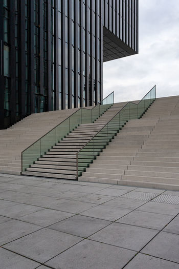 stairs and office building in Dusseldorf, Germany. Germany Düsseldorf Düsseldorf, Medienhafen City Rhine Tower Architecture Built Structure Staircase Building Building Exterior Steps And Staircases Railing Sky No People Direction Modern Day Outdoors Nature Wall - Building Feature The Way Forward Cloud - Sky Pattern Office Building Exterior Concrete