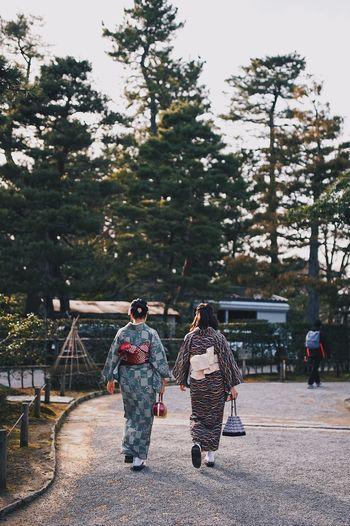 Rear view of women in kimonos walking on street